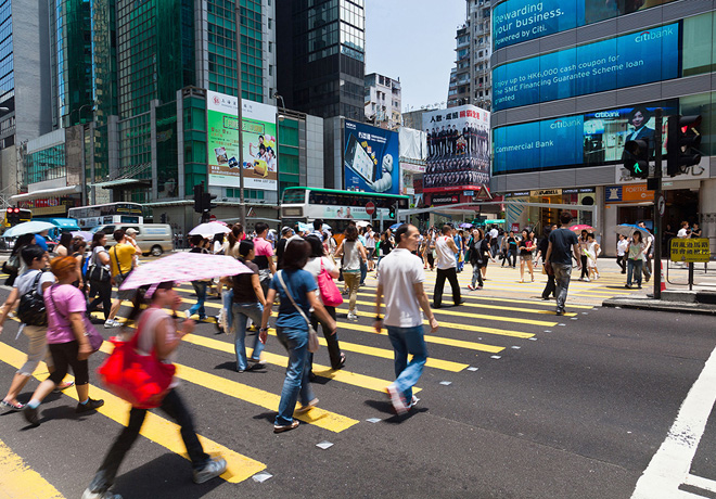 39469979 - hong kong, china - august 13, 2011: pedestrians crossing a busy crosswalk in mongkok, hong kong, with advestising boards and financial buildings in the background.