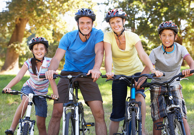 42249271 - family on cycle ride in countryside