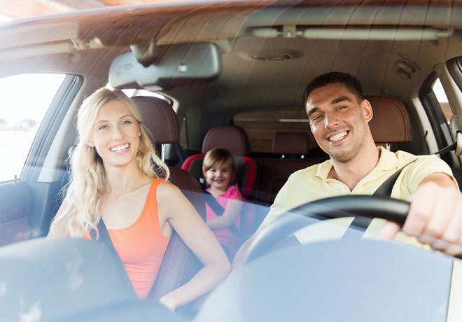 48854090 - family, transport, safety, road trip and people concept - happy man and woman with little child driving in car